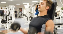 Male in gym with weights
